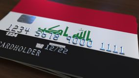 Пластиковая карта банка отличая флагом Ирака Анимация иракской национальной банковской системы родственная бесплатная иллюстрация