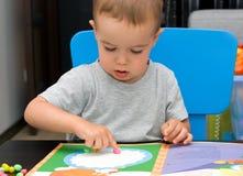 пластилин мальчика Стоковое Изображение RF