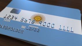 Пластичная карточка банка отличая флагом Аргентины Анимация национальной банковской системы родственная акции видеоматериалы