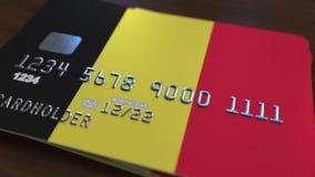 Пластичная карточка банка отличая флагом Бельгии Анимация национальной банковской системы родственная сток-видео