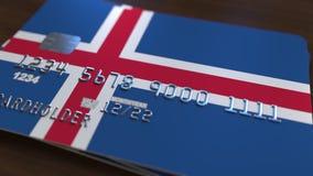 Пластичная карточка банка отличая флагом Исландии Анимация национальной банковской системы родственная сток-видео