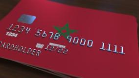 Пластичная карточка банка отличая флагом Марокко Анимация национальной банковской системы родственная акции видеоматериалы
