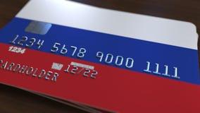 Пластичная карточка банка отличая флагом России Анимация национальной банковской системы родственная акции видеоматериалы