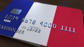 Пластичная карточка банка отличая флагом Франции Анимация национальной банковской системы родственная видеоматериал