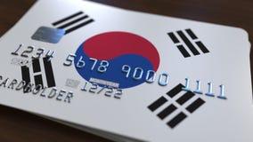Пластичная карточка банка отличая флагом Южной Кореи Анимация национальной банковской системы родственная акции видеоматериалы