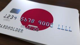 Пластичная карточка банка отличая флагом Японии Анимация национальной банковской системы родственная видеоматериал