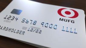 Пластичная карточка банка с логотипом Мицубиси UFJ Редакционная схематическая 3D анимация иллюстрация штока