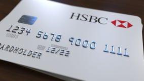 Пластичная карточка банка с логотипом HSBC Редакционная схематическая 3D анимация иллюстрация вектора