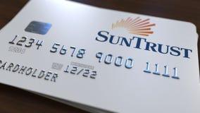 Пластичная карточка банка с логотипом банка SunTrust Редакционная схематическая 3D анимация иллюстрация вектора