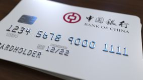 Пластичная карточка с логотипом Государственного банка Китая Редакционная схематическая 3D анимация иллюстрация штока