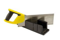 Пластично увидел, что угол отрезал инструмент коробки митры на белизне Стоковая Фотография
