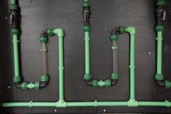 Пластичный зеленый цвет трубы Стоковое Изображение RF