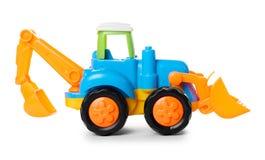 Пластичный трактор игрушки изолированный на белой предпосылке Стоковые Изображения