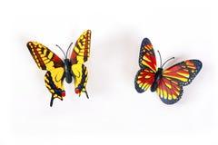 Пластмасса бабочки на белой предпосылке Стоковое Фото