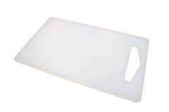 пластмасса вырезывания доски Стоковая Фотография