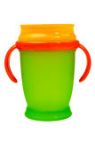 пластмасса померанца зеленого цвета чашки младенца Стоковая Фотография