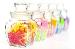 пластмасса сердца бутылки цветастая стеклянная Стоковая Фотография