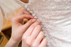 платье кнопок кладя венчание Стоковые Изображения RF