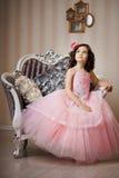 платье ребенка стула славное Стоковые Фотографии RF