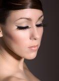 плетка девушки глаза стоковое фото
