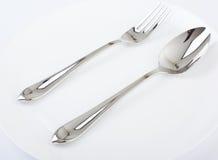 Плита, ложка и вилка обеда. Стоковые Фотографии RF