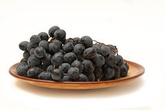 Плита с виноградинами Стоковая Фотография