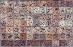 Плитки с handprints Стоковое Фото