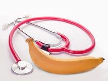 Плодоовощ банана, здоровая еда, наушники медицинские Стоковое Изображение RF