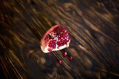 Плодоовощ гранатового дерева на предпосылке темного коричневого цвета Стоковое Фото