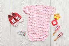 Плоский состав положения с одеждами младенца Стоковое Изображение