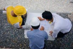 плоское положение команды инженера с светокопией Стоковое фото RF