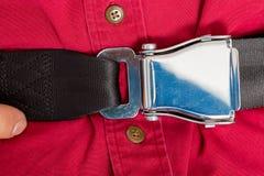 Плотно забортованная пряжка ремня безопасности на пассажире Стоковое Фото