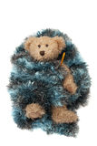 Плюшевый медвежонок при больной гриппа обернутый в одеяле Стоковое Фото