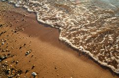 Пляж и прибой моря с движением Стоковые Фото