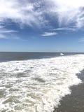пляж и cloudscape Стоковое Изображение