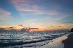 Пляж на заходе солнца Стоковая Фотография