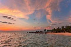 Пляж на заходе солнца стоковое фото rf