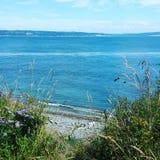 Пляж океана на летний день стоковые изображения