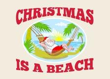 Пляж рождества отца Santa Claus ослабляя Стоковое Изображение