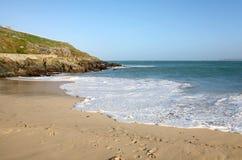 пляж porthgwidden белизна воды стоковое изображение
