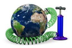Пневматический насос увеличивает землю планеты Стоковые Изображения
