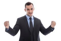 Победитель - успешный молодой бизнесмен в костюме и изолированном связью o стоковое фото