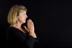 повелительница молит старший стоковые фото