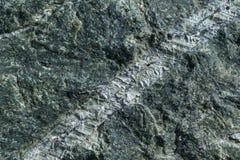 Поверхностный серый камень гранита с цепями световых маяков и штриховатостями Стоковое Изображение