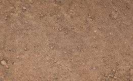 Поверхность Брайна земная Закройте вверх по естественной предпосылке Стоковое фото RF