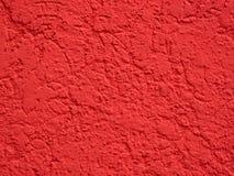 Поверхность заштукатуренная красным цветом Стоковая Фотография