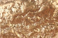 Поверхность золотого самородка с broan пятнами. Стоковая Фотография