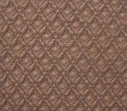 Поверхность коричневой вычисляемой текстуры покрывала ткани стоковые изображения rf