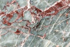 Поверхность красного цвета, белых и серых отполированная каменная Стоковые Изображения RF