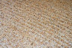 Поверхность небольшой песчинки каменная рисует картину как кривая дзэна как фоновое изображение Соберите различные средства массо стоковое фото
